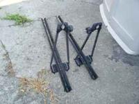 One roof rack mounted bike rack left. Call  or E-mail