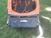 In-Step double bike trailer with coupler fitting for