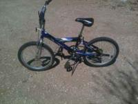 "Blue bike is a 20"" boys bike front hand break and"