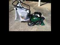 a commerical lawn vac made by billygoat and powerd by a