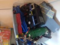 Bin of misc toy trucks and toys  $10  Txt only