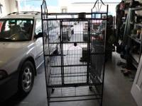 """Tall standing bird cage with wheels. Appox. 30"""" x 30"""""""