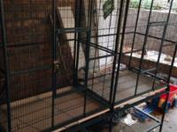 Large bird cage with divider. This ad was posted with