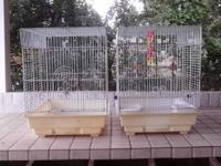 Two all white bird cages, both made use of but are