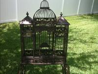 Decorative wrought iron cage or plant display. Bring