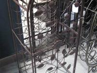 Bird cage wine shelfs. front door opens to keep your