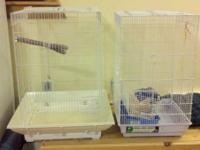 Two large bird cages and one small travel cage ,also