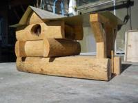log cabin bird house. 4 holes for birds, very nice.