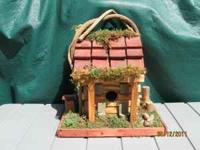 THIS IS A VERY FANCY LOG CABIN BIRDHOUSE. HAS A