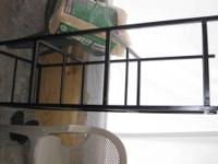Hello I have For sale a black birds cages stand that