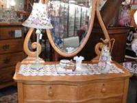 I have a beautiful maple dresser and mirror set for