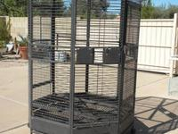 Two stacked large breeder cages on stand with wheels,