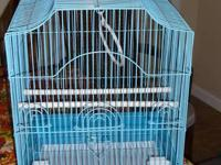 New white cage, never used, comes with perches, dishes