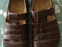 Fully enclosed women's Brown leather Birkenstock shoe,