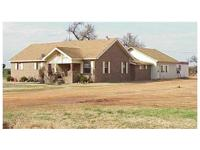 1.25+/- Acres w/Brick Home $148,500. 15912 S 66 TH ST