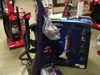 A brand new Bissell Pro Heat Pet 2 carpet washer! Comes