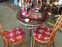 Bistro table with 3 bentwood coca cola chairs. Firm