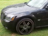 Fit a dodge magnum 2005...only 1 yr old universals 10