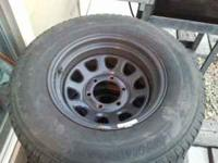 Black rims & tires for sale, tire is P235/75/15. The