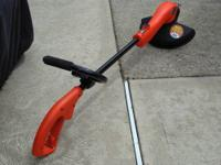 "Up for sale is a electric Black & Decker ""Grass Hog""."
