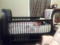 i have a nice black baby crib and mattress That i am