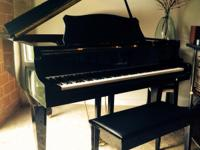 Black Baby Grand Piano in excellent condition. Moving