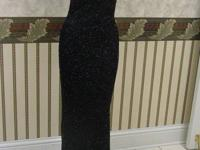 "This is a size 6 ""killer"" black evening dress.  Has"