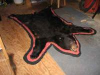 Black Bear Rug. Measures 72 inches long by 52 inches