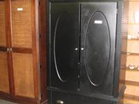 Lots of storage space in this beautiful black armoire,