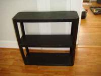 This is a medium sized Black plastic bookcase .The