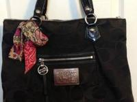 2 year old large black Poppy Coach purse. Good
