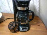 black and silver black&decker, with reusable coffee