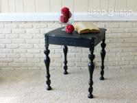 This beautiful, one of a kind antique black end table,