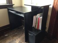 I'm selling a black student desk and a three-shelf