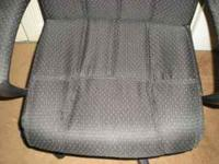 Black cloth desk chair. The material has tiny white