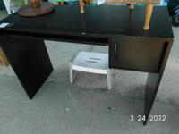 black desk has slide out tray and door for cabinet