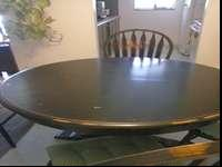 Back dining table with character wood showing.solid oak