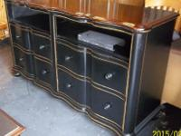 This Black distressed TV Console/Media Cabinet has been