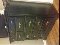 Hello am selling black dresser 8 drawer in Very good