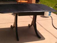 Black drop leaf table with 2 chairs. Missing middle