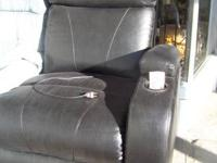 GREAT CONDITION.........ELECTRIC RECLINES AND SIT YOU