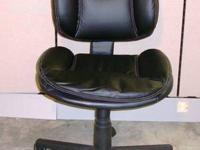 I have a black synthetic leather workplace chair for