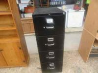 Nice Black Filing Cabinet. Needs a good home. Located
