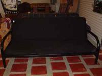 Very well made and extremey sturdy black futon couch in