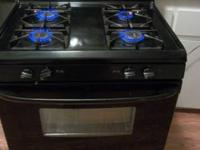 black gas stove I believe its a kenmore its not too old