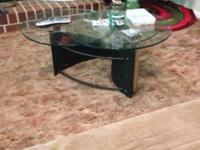 Black and gun metal based coffee table, with three