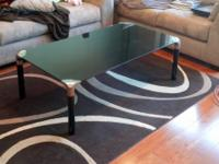 Black glass coffee table.  Like-new condition.  No