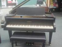 Beautiful black grand piano, reconditioned, bench