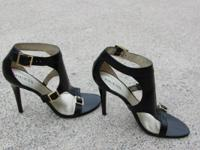A pair of 31/2 inch Guess high heels, size 81/2, but