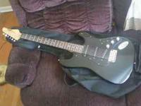 Black guitar in very good condition. Best way to reach